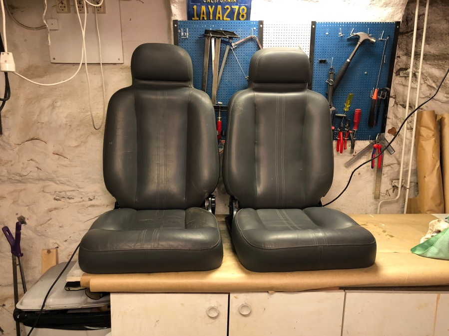 glued rips in drivers side seat